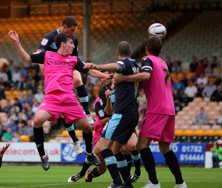 Burnley's Chris McCann scores his sides first goal  ..Football - Football - Capital One Cup First Round - Port Vale v Burnley - Tuesday 14th August 2012 - Vale Park - Burslem. .