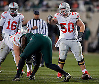 Ohio State Buckeyes offensive lineman Jacoby Boren (50) and Ohio State Buckeyes offensive lineman Pat Elflein (65) against Michigan State Spartans at Spartan Stadium in East Lansing, Michigan on November 8, 2014.  (Dispatch photo by Kyle Robertson)