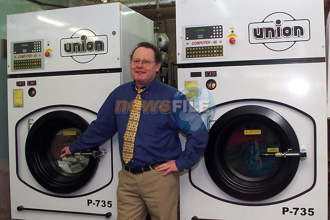 Frank Flynn works the new machines at Gala Cleaners in St Peters street..pic: Newsfile