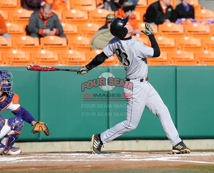 Third baseman Eric Brenk (33) of the Wofford Terriers in a game against the Clemson Tigers on Wednesday, March 6, 2013, at Doug Kingsmore Stadium in Clemson, South Carolina. Clemson won, 9-2. (Tom Priddy/Four Seam Images)