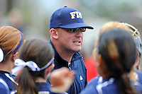11 February 2012:  FIU Head Coach Jake Schumann speaks with his players in between innings as the University of Louisville Cardinals defeated the FIU Golden Panthers, 4-2, as part of the COMBAT Classic at the FIU Softball Complex in Miami, Florida.