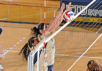 Florida International University women's volleyball player Paola Ortiz (11) plays against Florida A&M University.  FIU won the match 3-0 on September 11, 2011 at Miami, Florida. .