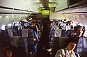 Turkey 1991.Iraqi Kurds on their way to France, in the plane