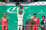 Mercedes driver Lewis Hamilton (44) of Great Britain, Ferrari driver Kimi Raikkonen (7) of Finland and Ferrari driver Sebastian Vettel (5) of Germany on the podium after the Formula 1 United States Grand Prix race at the Circuit of the Americas race track in Austin,Texas.