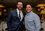 WOLCOTT, CT. 05 April 2018-040518BS09 - From left, Todd Burton of Thomaston Savings Bank stands next to Wolcott Fire Chief Kyle Dunn at the Wolcott Chamber of Commerce awards banquet at Mahan's Lakeview in Wolcott on Thursday evening. Bill Shettle Republican-American