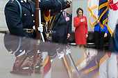 The Honor Guard is reflected as they stand at attention as the United States National Anthem is played during a ceremony dedicating a chair in the United States Capitol Building to honor United States soldiers labeled as 'Prisoners of War' or 'Missing in Action' at the United States Capitol Building in Washington, D.C. on November 8th, 2017. <br /> Credit: Alex Edelman / CNP