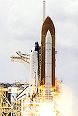 Cape Canaveral, FL -  May 11, 2009 -- Space Shuttle Atlantis and its seven-member STS-125 crew head toward Earth orbit and rendezvous with NASA's Hubble Space Telescope. Liftoff was on time at 2:01 p.m. (EDT) on May 11, 2009 from launch pad 39A at NASA's Kennedy Space Center. Onboard are astronauts Scott Altman, commander; Gregory C. Johnson, pilot; Michael Good, Megan McArthur, John Grunsfeld, Mike Massimino and Andrew Feustel, all mission specialists. Atlantis' 11-day flight will include five spacewalks to refurbish and upgrade the telescope with state-of-the-art science instruments that will expand Hubble's capabilities and extend its operational lifespan through at least 2014. The payload includes Wide Field Camera 3, fine guidance sensor and the Cosmic Origins Spectrograph..Credit: NASA via CNP
