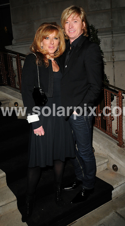 **ALL ROUND PICTURES FROM SOLARPIX.COM**.**WORLDWIDE SYNDICATION RIGHTS**.Arrivals at the Dom Perignon event hosted by Claudia Schiffer, Portland Place, London.  26th February 2008...This pic: Kelly Hoppen and Nicky Clarke..JOB REF: 5842 SSD     DATE: 28_02_2008.**MUST CREDIT SOLARPIX.COM OR DOUBLE FEE WILL BE CHARGED* *UNDER NO CIRCUMSTANCES IS THIS IMAGE TO BE REPRODUCED FOR ANY ONLINE EDITION WITHOUT PRIOR PERMISSION*