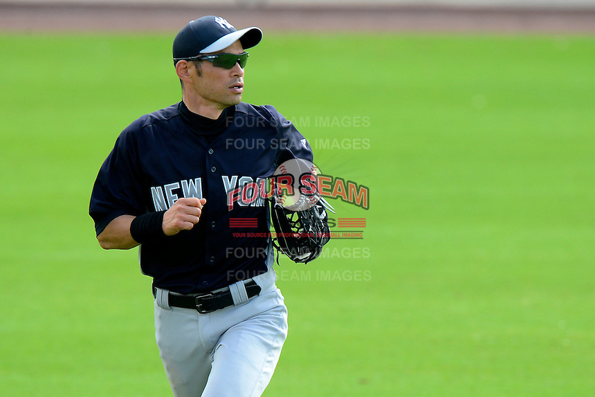 New York Yankees outfielder Ichiro Suzuki #31 reacts to a hit ball during a Spring Training game against the Philadelphia Phillies at Bright House Field on February 26, 2013 in Clearwater, Florida.  Philadelphia defeated New York 4-3.  (Mike Janes/Four Seam Images)