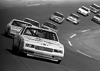 Dale Earnhardt leads a pack of cars out of turn 4 during a qualifying race at Daytona in February 1986, (Photo by Brian Cleary)