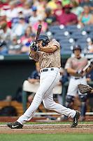 Virginia Cavaliers shortstop Daniel Pinero (22) swings the bat against the Arkansas Razorbacks in Game 1 of the NCAA College World Series on June 13, 2015 at TD Ameritrade Park in Omaha, Nebraska. Virginia defeated Arkansas 5-3. (Andrew Woolley/Four Seam Images)