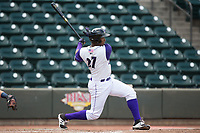 Eloy Jimenez (27) of the Winston-Salem Dash follows through on his swing against the Potomac Nationals at BB&T Ballpark on August 6, 2017 in Winston-Salem, North Carolina.  The Nationals defeated the Dash 4-3 in 10 innings.  (Brian Westerholt/Four Seam Images)