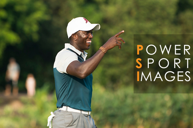 Dwight Yorke plays his last shot during the World Celebrity Pro-Am 2016 Mission Hills China Golf Tournament on 23 October 2016, in Haikou, Hainan province, China. Photo by Marcio Machado / Power Sport Images