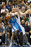 Dallas Mavericks' Jason Kidd goes after the ball against New Orleans Hornets' Darren Collison, left, causing a jump ball during an NBA basketball game at American Airlines Center in Dallas on February 28, 2010.   (Photo by Khampha Bouaphanh)
