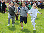 Cole Everitt (in white) wins the under 10 race at Moneymore sports day. Photo: www.pressphotos.ie