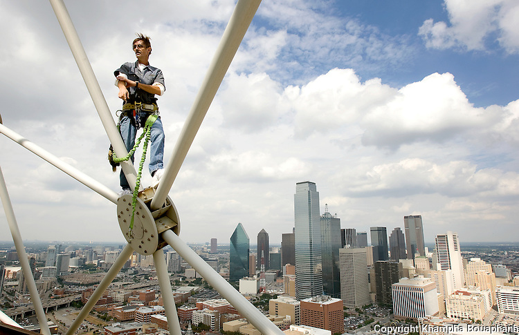 A Hyatt Hotel employee poses on top of Reunion Tower overlooking the the downtown Dallas skyline on September 18, 2008.  (photo by Khampha Bouaphanh)