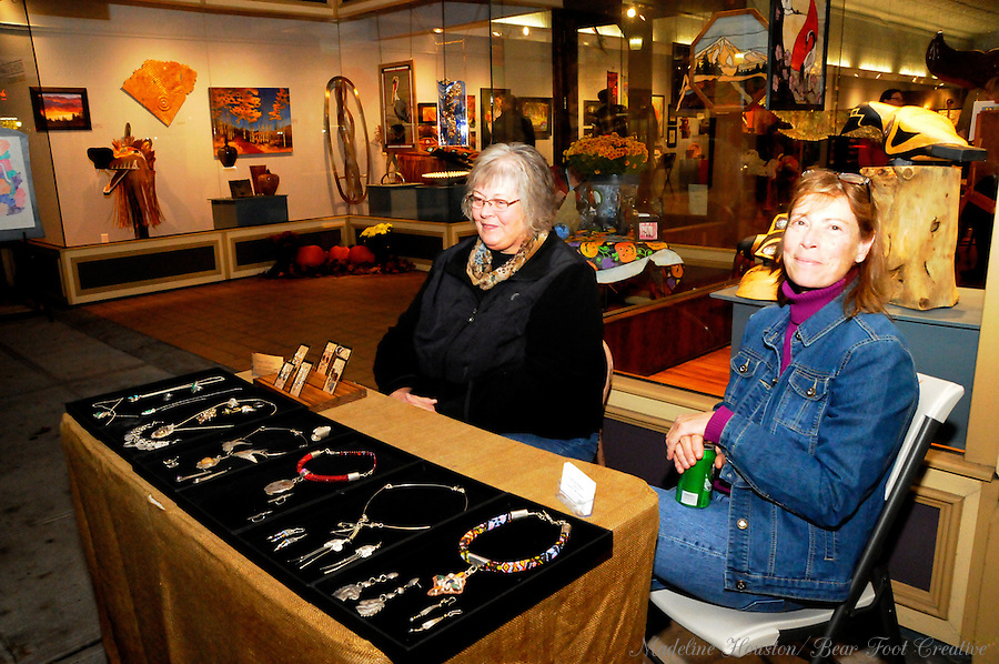Jewelry artists Nancy Wigley and Pauline Phillips display their creations in front of the Rectangle Gallery during Centralia, Washington's Third Thursday on October 20, 2016.