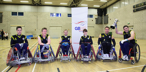27 MAY 2013 - DONCASTER, GBR - The Stoke Mandeville Marauders team, (from the left) Chris Ryan, Luke White, Johnny Coggan, Nathalie McGloin, Darren Mitchell and Justin Frishberg celebrate winning the 2013 Great Britain Wheelchair Rugby Nationals at The Dome in Doncaster, South Yorkshire (PHOTO (C) 2013 NIGEL FARROW)