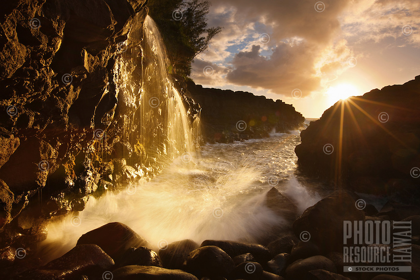 The sun bursts through in spectacular fashion near Queens Bath on Kauai's north shore.