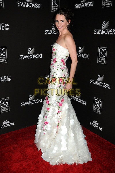 JANIE BRYANT .Attending the 12th Annual Costume Designers Guild Awards held at the Beverly Hilton Hotel.  .Beverly Hills, California, USA,  .25th February 2010 .arrivals full length strapless white long maxi dress pink flower floral pattern paillettes shiny side .CAP/ADM/BP.©Byron Purvis/AdMedia/Capital Pictures.