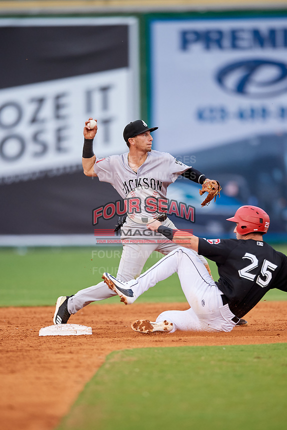 Jackson Generals shortstop Galli Cribbs (2) turns a double play as Brent Rooker (25) slides into second base during a game against the Chattanooga Lookouts on May 9, 2018 at AT&T Field in Chattanooga, Tennessee.  Chattanooga defeated Jackson 4-2.  (Mike Janes/Four Seam Images)