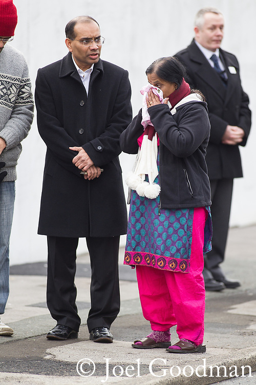 © Joel Goodman - 07973 332324 . 02/01/2012 . Salford , UK . Anuj's mother Yogini . The parents of Anuj Bidve visit the scene of Anuj Bidve's murder, on Ordsall Lane , where a memorial shrine of flowers, candles and messages has been built . Bidve was shot and killed by Kiaran Stapleton on 26 December 2011 . Photo credit: Joel Goodman