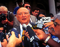 Former New York City Mayor Edward I. Koch speaks to the press at endorsement of Hispanic city councilmembers at New York City Hall on August 20, 1993. (© Frances M. Roberts)