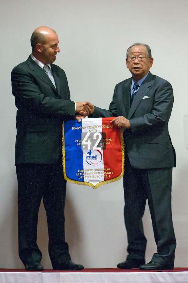16 July 2011: Japanese Hall of famer Yoshio Yoshida, of the Hanshin Tigers, and former France Team Manager poses with Didier Seminet of French Federation of Baseball as he is honored by the French Federation of Baseball during the 2011 Challenge de France in Rouen, France.