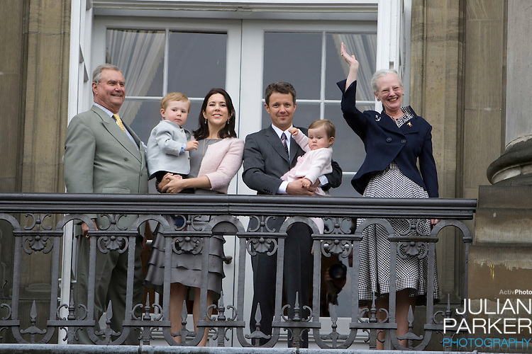 Crown Prince Frederick and Crown Princess Mary of Denmark and their children, Prince Christian ( age 2 ), and Princess Isabella ( age 1 ) with Queen Margrethe of Denmark, and Prince Henrik on the Balcony of Amalienborg Palace in Copenhagen to celebrate Crown Prince Frederiks 40th Birthday