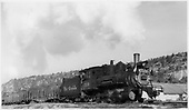 D&amp;RGW C-18 #319 with train at Dolores.<br /> RGS  Dolores, CO  Taken by Peyton, Ernie S. - 3/1949