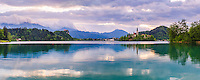 Lake Bled landscape at sunrise, showing the Church on Lake Bled Island and Bled Castle, Gorenjska Region, Slovenia, Europe