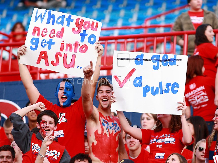 Dec 6, 2008; Tucson, AZ, USA; A group of Arizona Wildcats fans hold up signs prior to a game against the Arizona State Sun Devils at Arizona Stadium.  Arizona won the game 31-10.