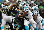 Carolina Panthers  running back Johnathan Stewart (28) is tuned back by Seattle Seahawks Bruce Ivin (51) and MIchael Bennett (72) t CenturyLink Field in Seattle on October 18, 2015. The Panthers came from behind with 32 seconds remaining in the 4th Quarter to beat the Seahawks 27-23.  ©2015 Jim Bryant Photography. All Rights Reserved.