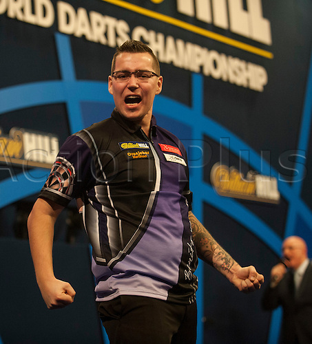 21.12.2014.  London, England.  William Hill PDC World Darts Championship.  Benito van de Pas [NED] celebrates the winning double in his match against Paul Nicholson (25) [AUS]. van de Pas won the match 3-2.