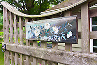"""Garden entrance entry, gate with sign that reads """"To the Garden"""" charming inviting welcome"""