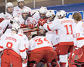 Miami huddles - The Boston College Eagles defeated the Miami University Redhawks 5-0 in their Northeast Regional Semi-Final matchup on Friday, March 24, 2006, at the DCU Center in Worcester, MA.