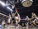SIOUX FALLS, SD: MARCH 5: Mikaela Shaw #22 of Nebraska Omaha drives between South Dakota defenders  during the Summit League Basketball Championship on March 5, 2017 at the Denny Sanford Premier Center in Sioux Falls, SD. (Photo by Dick Carlson/Inertia)