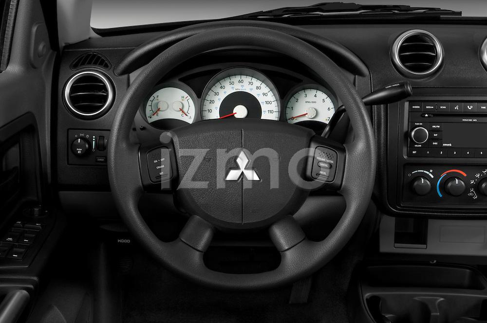 Steering wheel view of a 2008 Mitsubishi Raider pickup truck