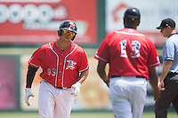 Ricky Oropesa (33) of the Richmond Flying Squirrels is congratulated by Richmond Flying Squirrels manager Jose Alguacil (13) as he rounds third base after hitting a 3-run home run against the Bowie Baysox at The Diamond on May 25, 2015 in Richmond, Virginia.  The Flying Squirrels defeated the Baysox 6-1. (Brian Westerholt/Four Seam Images)