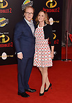HOLLYWOOD, CA - JUNE 05: Brad Bird (L) and Elizabeth Canney attend the premiere of Disney and Pixar's 'Incredibles 2' at the El Capitan Theatre on June 5, 2018 in Los Angeles, California.