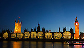 London, England, UK. Saturday, 4 August 2012. Giant images displaying British and International Olympic athletes from the past and present are projected onto the facade of the Houses of Parliament, London, for the duration of the Olympic Games and Paralympic Games 2012.
