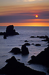 Northern Oregon Coast silhouetted rock formations at sunset at Ecola State Park near Cannon beach Oregon State USA.