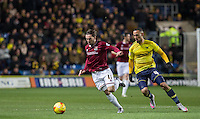 Ricky Holmes of Northampton Town holds off Kemar Roofe of Oxford United during the Sky Bet League 2 match between Oxford United and Northampton Town at the Kassam Stadium, Oxford, England on 16 February 2016. Photo by Andy Rowland.
