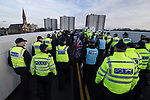 © Joel Goodman - 07973 332324 . 20/01/2018. Doncaster, UK. Far-right street protest movement , the English Defence League ( EDL ) , march after holding a demonstration , opposed by anti-fascists , including Unite Against Fascism ( UAF ) in the Hexthorpe area of Doncaster . EDL supporters chanted anti-Roma slogans as they marched through the town . Photo credit : Joel Goodman