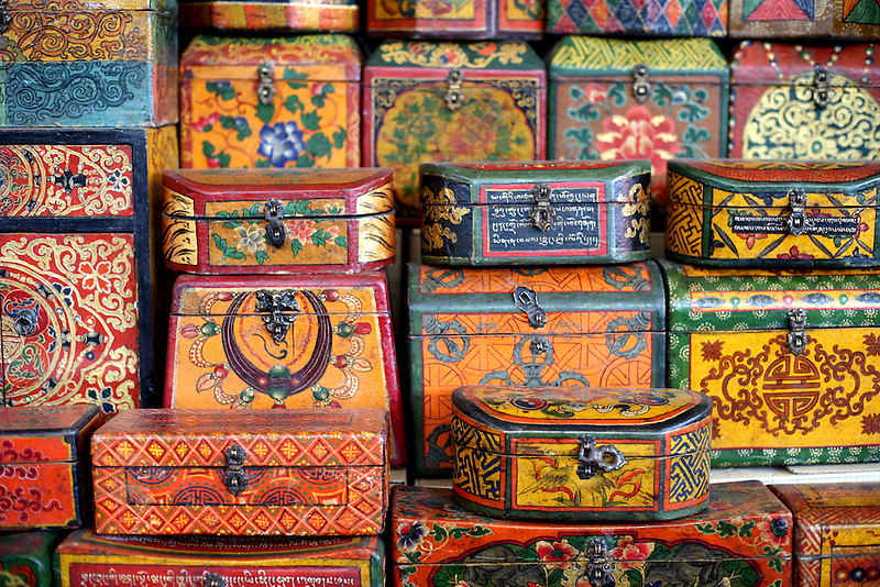 Tibetan boxes for sale in Beijing's infamous Panjiayuan Market May 28, 2006. The market started out as an unofficial flea market back in the early 90's but has quickly grown in size and popularity. Open on Saturday and Sunday, Panjiayuan's treasure trove of antiques and oddities now has approximately 3,000 registered stallholders, and up to 50,000 visitors on a busy day. Whether you're looking for that 14th century Ming vase or Cultural Revolution kitsch, be sure to start early. Panjiayuan opens at 4.30am and it's best to hit the market before everyone else does...