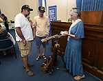 Docent Joyce Gebo talks with Anson Reynolds and Rob Rangel at the reception following the USS Nevada Centennial of Launch ceremony at the Capitol, in Carson City, Nev., on Friday, July 11, 2014. The telescope was formerly on the bridge of the USS Nevada.<br /> Photo by Cathleen Allison
