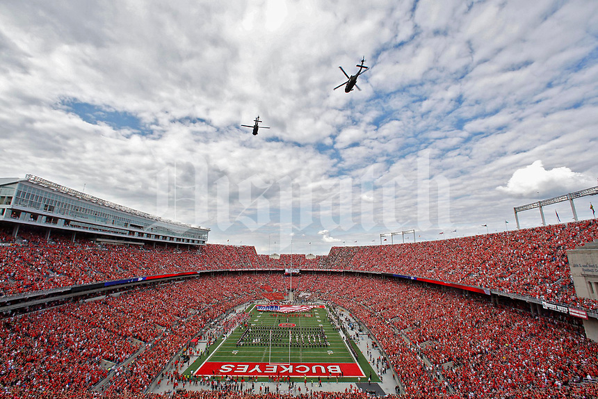 Following the National Anthem, Helicopters fly over Ohio Stadium in a missing-man formation in tribute to John Glenn before Saturday's NCAA Division I football game between the Army Black Knights and the Ohio State Buckeyes in Columbus on September 16, 2017. [Barbara J. Perenic/Dispatch]
