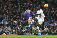 Bafetibis Gomis collides with Joe Hart during the Barclays Premier League Match between Manchester City and Swansea City played at the Etihad Stadium, Manchester on 12th December 2015