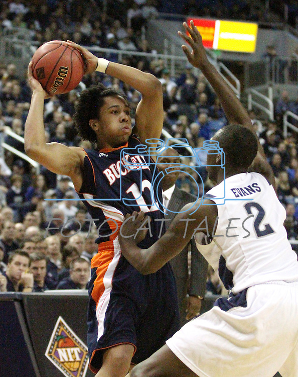Nevada's Jerry Evans defends against Bucknell's Bryson Johnson during a second round NIT college basketball game in Reno, Nev., on Sunday, March 18, 2012. Nevada won 75-67..Photo by Cathleen Allison