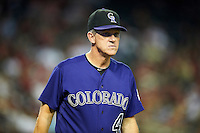 Colorado Rockies manager Jim Tracy #4 during a National League regular season game against the Arizona Diamondbacks at Chase Field on October 3, 2012 in Phoenix, Arizona. Colorado defeated Arizona 2-1. (Mike Janes/Four Seam Images)